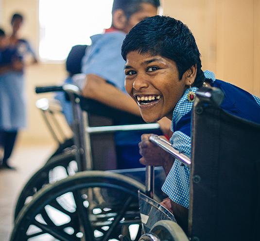 Child in wheelchair smiling